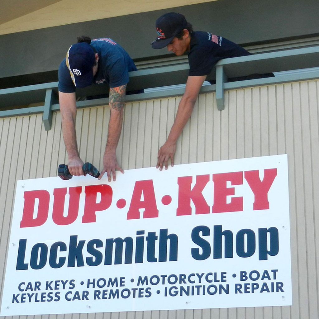 vince-and-diego-hanging-locksmith-shop-sign-1000